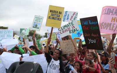 A group of people holding a sign