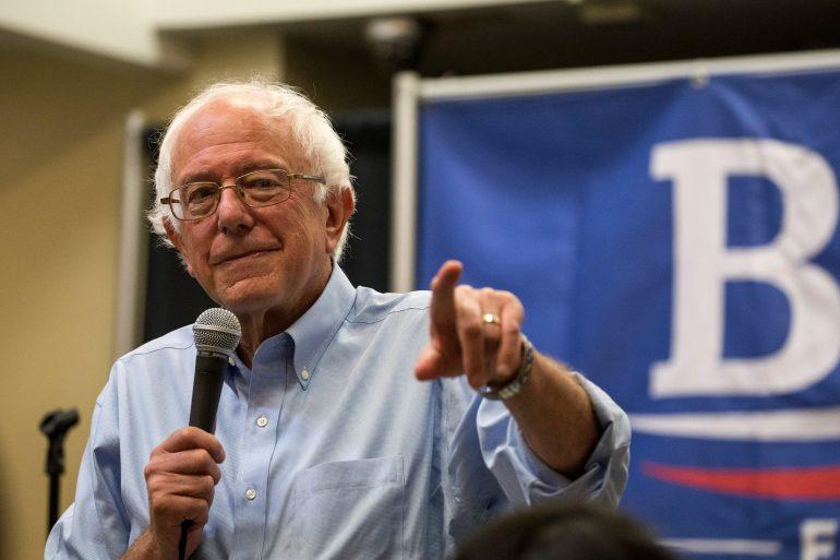 Bernie Sanders holding a microphone