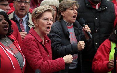 Elizabeth Warren, Randi Weingarten in uniform standing in front of a crowd