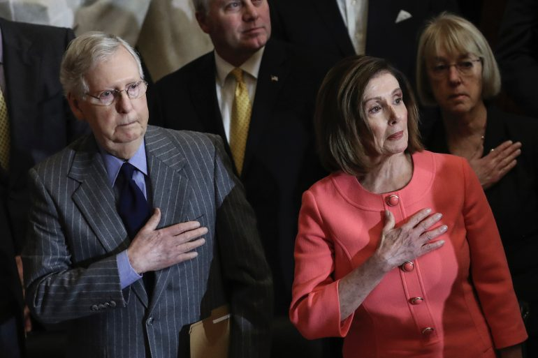 Mitch McConnell, Patty Murray standing next to a man in a suit and tie