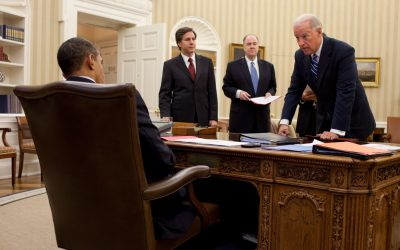 Tony Blinken, Joe Biden sitting at a desk