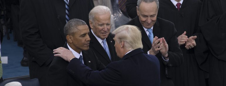 Barack Obama, Joe Biden, Chuck Schumer standing next to a person in a suit and tie
