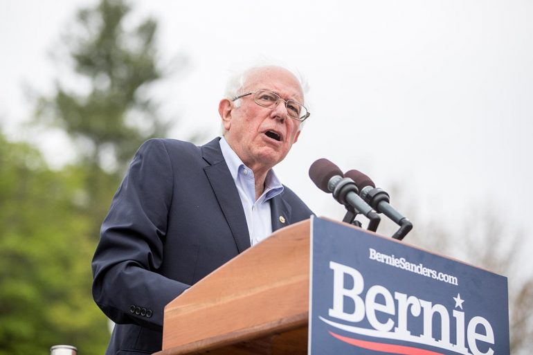 Bernie Sanders holding a sign
