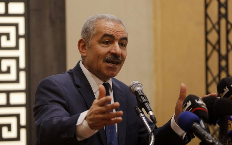 Mohammad Shtayyeh wearing a suit and tie